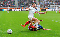 Heather O'Reilly (l) of team USA and Sandrine Soubeyrand of team France during the FIFA Women's World Cup at the FIFA Stadium in Moenchengladbach, Germany on July 13th, 2011.
