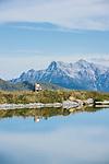 Austria, Tyrol, above Kirchberg in Tyrol, near Kitzbuhel: reservoir 'Ehrenbachhoehe', at background Loferer Steinberge mountains | Oesterreich, Tirol, oberhalb Kirchberg in Tirol: Speichersee Ehrenbachhoehe, im Hintergrund die Loferer Steinberge