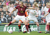 Arsenal vs Leeds United - Womens FA Cup Final at Millwall Football Club - 01/05/06 - Arsenal's Faye White (left) creates some mayhem in the Leeds area - (Gavin Ellis 2006)