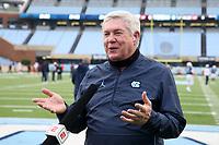 CHAPEL HILL, NC - OCTOBER 10: North Carolina head coach Mack Brown is interviewed by ESPN before a game between Virginia Tech and North Carolina at Kenan Memorial Stadium on October 10, 2020 in Chapel Hill, North Carolina.