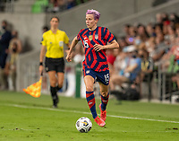 AUSTIN, TX - JUNE 16: Megan Rapinoe #15 of the USWNT dribbles the ball during a game between Nigeria and USWNT at Q2 Stadium on June 16, 2021 in Austin, Texas.