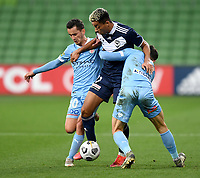 6th June 2021; AAMI Park, Melbourne, Victoria, Australia; A League Football, Melbourne Victory versus Melbourne City; Ben Folami of the Victory bursts between Adrian Luna and Aiden O'Neill of Melbourne City