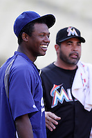 Hanley Ramirez #13 of the Los Angeles Dodgers visits with former Manager Ozzie Guillen #13 of the Miami Marlins before a game at Dodger Stadium on August 24, 2012 in Los Angeles, California. Los Angeles defeated Miami 11-4. (Larry Goren/Four Seam Images)