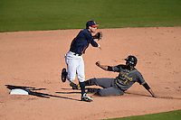 Cal State Fullerton Titans infielder Jake Jefferies (4) throws to first as Waldyvan Estrada (14) slides in during a game against the Alabama State Hornets on February 14, 2015 at Bright House Field in Clearwater, Florida.  Alabama State defeated Cal State Fullerton 3-2.  (Mike Janes/Four Seam Images)