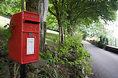 Royal Mail post box on a remote country road in the Croesor Valley in Snowdonia, North Wales.