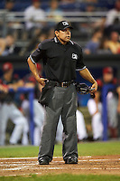 Umpire Jhonatan Biarreta during a game between the Staten Island Yankees and Batavia Muckdogs on August 26, 2016 at Dwyer Stadium in Batavia, New York.  Staten Island defeated Batavia 6-2.  (Mike Janes/Four Seam Images)