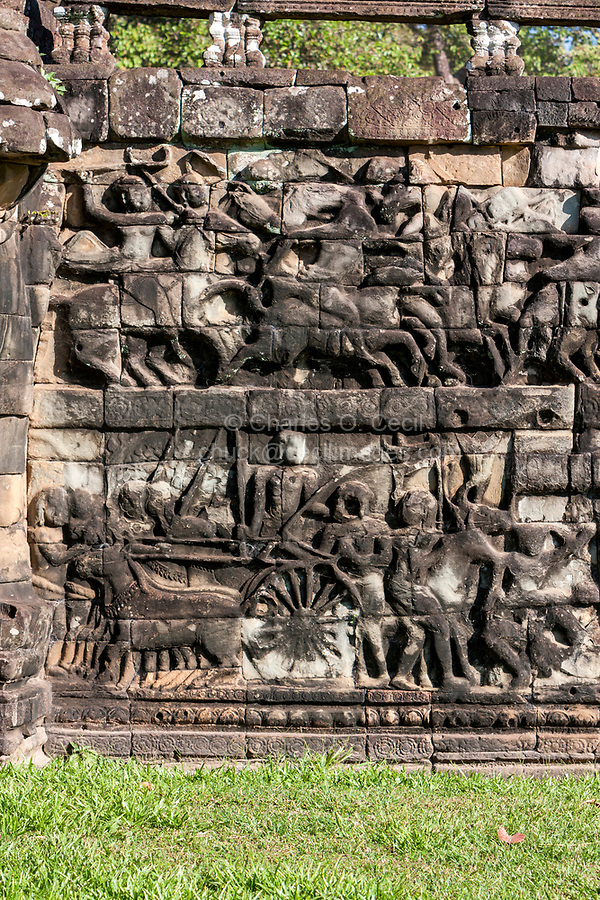 Cambodia, Angkor Thom.  Stone Carvings Depicting Soldiers in Battle,  with Horses and Cart.