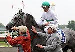 4 July 2009: INFORMED DECISION with jockey Julien R. Leparoux are greeted by trainer Jonathan Sheppard at the winner's circle after winning the 21st running of the Chicago Handicap at Arlington Park in Arlington Heights, Illinois.
