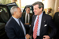 US Secretary of State Colin Powell greets US Ambassador to Iraq (IRQ), the honorable Paul Bremer outside of the Coalition Provisional Authority (CPA) Headquarters in Baghdad, Iraq during Operation IRAQI FREEDOM.