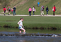 15/04/15<br /> <br /> On the hottest day of the year, tourists flock to cool-off as they cross stepping stones crossing the river Dove at Dovedale, near Ashbourne, in the Derbyshire Peak District.<br /> <br /> All Rights Reserved - F Stop Press.  www.fstoppress.com. Tel: +44 (0)1335 418629 +44(0)7765 242650