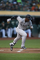 OAKLAND, CA - SEPTEMBER 4:  Andrew McCutchen #26 of the New York Yankees runs to first base against the Oakland Athletics during the game at the Oakland Coliseum on Tuesday, September 4, 2018 in Oakland, California. (Photo by Brad Mangin)