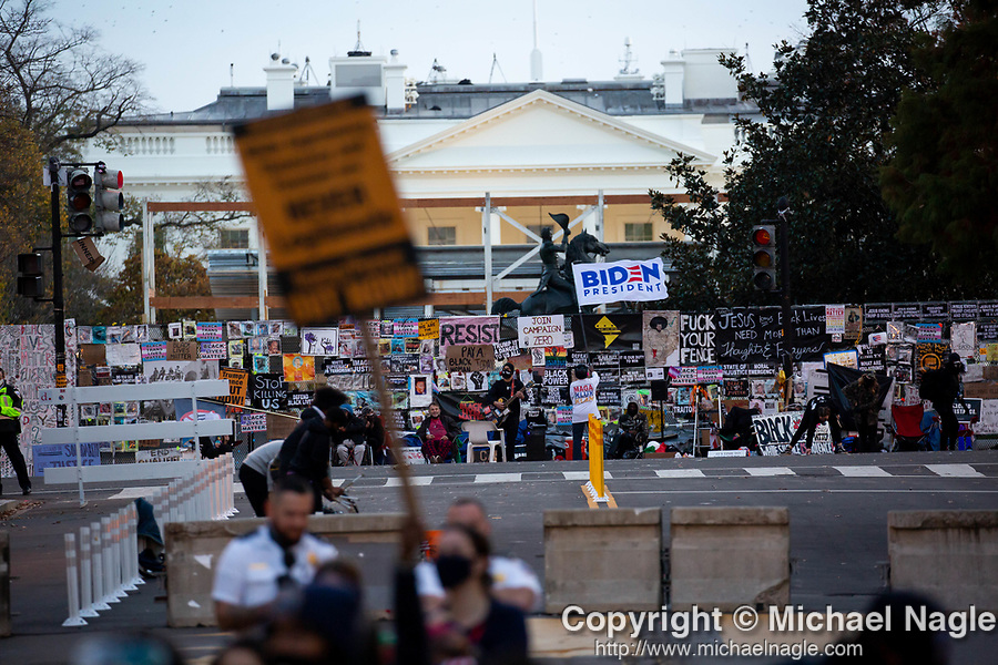 """Anti -Trump protesters demonstrate in front of the White House during the """"Million MAGA March"""" on November 14, 2020 in Washington, D.C.  Thousands of supporters of U.S. President Donald Trump gathered to protest the results of the 2020 presidential election won by President-Elect Joe Biden.  Photograph by Michael Nagle"""