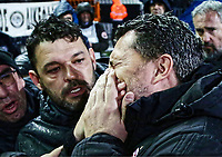 Pictured: Olympiakos' manager Oscar Garcia (R) after he got injured in the Toumba Stadium in Thessaloniki, Greece. Sunday 25 February 2018<br /> Re: Sunday's Greek Super League derby between PAOK Thessaloniki and Olympiakos was called off after Olympiakos' manager Oscar Garcia was struck in the face by an object believed to be a till machine paper roll, thrown by a spectator minutes before kick-off.<br /> Garcia left Toumba Stadium for a local hospital to seek treatment for a bloodied lip.<br /> The incident prompted the Olympiakos team to leave the pitch in protest before riots erupted outside the ground.<br /> Angry PAOK fans leaving the stadium then clashed with police who used tear gas to quell the violence.