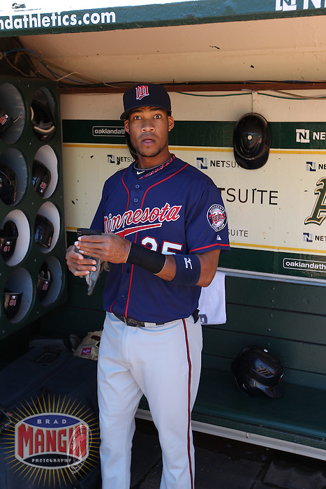 OAKLAND, CA - AUGUST 22:  Pedro Florimon #25 of the Minnesota Twins gets ready in the dugout before the game against the Oakland Athletics at O.co Coliseum on Wednesday, August 22, 2012 in Oakland, California. Photo by Brad Mangin