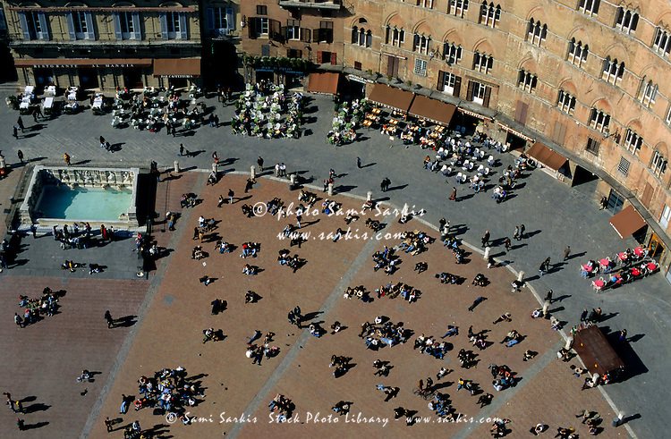 People in the Piazza del Campo seen from Torre del Mangia, Siena, Italy.