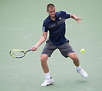 Mikhail Youzhny (RUS) defeats Jo Wilfried Tsonga (FRA) 6-1, 6-4 at the Western & Southern Open in Mason, OH on August 12, 2014.