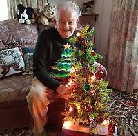 BNPS.co.uk (01202 558833)<br /> Pic: MaxLiverton/BNPS<br /> <br /> Max's late father Ray with the lights in 2016.<br /> <br /> Still Glowing Strong...<br /> <br /> What are believed to be Britain's oldest working fairy lights have been switched on - for the 72nd Christmas out of the last 73.<br /> <br /> Max Liverton inherited the string of 12 lights after his father Ray died a few weeks before last Christmas.<br /> <br /> At the time Max, 55, couldn't find the lights amid all the old boxes left for him inside his dad's home.<br /> <br /> It meant that last Christmas was the first one the trusty old lights hadn't been used since they were bought in 1946 by Max's grandfather, Burt.