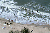 Natal, Brazil. Swimmers and sunbathers on the beach at Pipa.