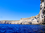 Blue Waters against cliffs at Blue Grotto
