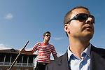 Venice Italy 2009. Venetian man goes to work on a Gondola.