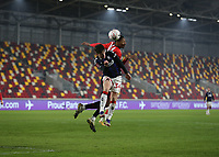 9th January 2021; Brentford Community Stadium, London, England; English FA Cup Football, Brentford FC versus Middlesbrough; Hayden Hackney of Middlesbrough heads the ball away past Ethan Pinnock of Brentford