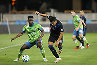 SAN JOSE, CA - OCTOBER 18: Yeimar Gomez Andrade #28 of the Seattle Sounders battles for the ball with Andy Rios #25 of the San Jose Earthquakes during a game between Seattle Sounders FC and San Jose Earthquakes at Earthquakes Stadium on October 18, 2020 in San Jose, California.
