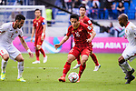Do Hung Dung of Vietnam (C) in action during the AFC Asian Cup UAE 2019 Round of 16 match between Jordan (JOR) and Vietnam (VIE) at Al Maktoum Stadium on 20 January 2019 in Dubai, United Arab Emirates. Photo by Marcio Rodrigo Machado / Power Sport Images