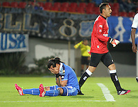 BOGOTA -COLOMBIA. 02-02-2014. Dayro Moreno en el piso se lamenta al no anotar gol a la  Equidad .Millonarios perdio un gol por cero contra La Equidad. partido por la segunda fecha de La liga Postobon 1 disputado en el estadio El Campin. / Dayro Moreno on the floor laments losing the annotation for Equity. Millonarios lost a goal against Equity zero. game for the second date of the Postobon one league match at El Campin Stadium. Photo: VizzorImage/ Felipe Caicedo / Staff