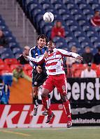 Colorado defender and captain Pablo Mastroeni wins a head ball over FC Dallas forward Roberto Mina. The Colorado Rapids drew 0-0 with FC Dallas in the first game of the Western Conference Semi-finals Invesco Field at Mile High, Denver, Colorado, September 22, 2005.