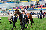 Mondialiste (IRE)(7) with Jockey Fearghal Lynch aboard make their way to the winner's circle after they ran to victory at the Ricoh Woodbine Mile Stakes at Woodbine Race Course in Toronto, Canada on September 13, 2015.