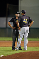 Bristol Pirates manager Miguel Perez (41) talks with umpire Zachary Robbins during a game against the Bluefield Blue Jays on July 26, 2018 at Bowen Field in Bluefield, Virginia.  Bristol defeated Bluefield 7-6.  (Mike Janes/Four Seam Images)