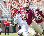 Florida State defensive tackle Marvin Wilson (21) moves in for there sack of Louisville quarterback Malik Cunningham (3) in the first half of an NCAA college football game in Tallahassee, Fla., Saturday, Sept. 21, 2019.