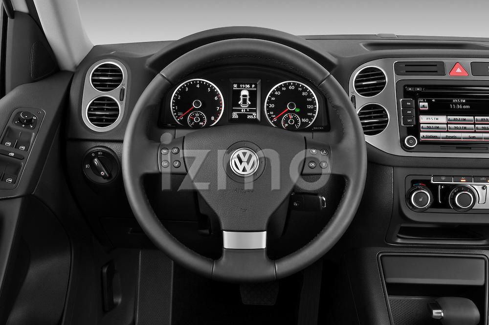 Steering wheel view of a 2010 Volkswagen Tiguan Wolfsburg SUV  Stock Photo