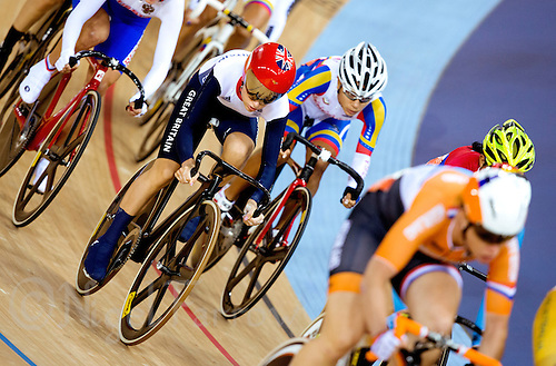 06 AUG 2012 - LONDON, GBR - Laura Trott (GBR) (left in red helmet) of Great Britain rides in the pack during the Women's Omnium 20km Points Race at the London 2012 Olympic Games track cycling at the Olympic Park Velodrome in Stratford, London, Great Britain .(PHOTO (C) 2012 NIGEL FARROW)