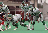 Eddie Lowe Nick Hebeler Saskatchewan Roughriders 1987. Photo F. Scott Grant