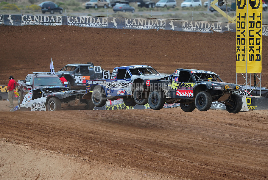 Mar. 20, 2011; Chandler, AZ, USA;  LOORRS pro four driver Kyle Leduc leads Travis Coyne during round two at Firebird International Raceway. Mandatory Credit: Mark J. Rebilas-