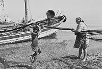 - maintenance of the nets of a fishing boat on a beach of Gioia Tauro plain ....- manutenzione delle reti di un peschereccio su una spiaggia della piana di Gioia Tauro