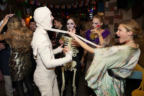 Amber Atherton strips an Egyptian mummy at the Myflashtrash Halloween Party  at Barrio, Soho, London