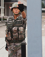 A Chinese People's Liberation Army (PLA) soldier tells the photographer not to take a photo at their barracks on day three of the mass civil disobedience campaign Occupy Central, Hong Kong, China, 30 September 2014. Their is widespread fear in Hong Kong that the PLA will enforce a crackdown similar to the one that took place in Beijing's Tiananmen Square in 1989 killing many student protesters.