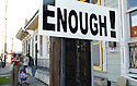 Enough! sign at murder site in the Marigny, 2007