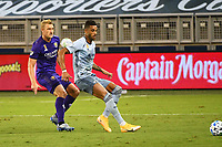 KANSAS CITY, KS - SEPTEMBER 23: Khiry Shelton #11 of Sporting Kansas City watched by Robin Jansson #6 of Orlando City during a game between Orlando City SC and Sporting Kansas City at Children's Mercy Park on September 23, 2020 in Kansas City, Kansas.