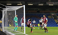 17th February 2021; Turf Moor, Burnley, Lanchashire, England; English Premier League Football, Burnley versus Fulham; Robbie Brady of Burnley is unable to prevent Ola Aina of Fulham scoring the opening goal after 48 minutes