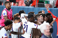 6th June 2021. Denver, Colorado, USA;  United States forward Christian Pulisic celebrates with teammates after scoring a goal from a penalty kick in extra time action during the CONCACAF Nations League finals between Mexico and the United States  at Empower Field at Mile High in Denver, CO.