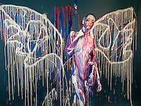 Switzerland. Canton Ticino. Lugano. Action painting. Butterfly. Beautiful naked woman with colors painted on her body. Model Sabrina Cereseto. Painters Benedetta Carugati e Lilyana Sepulveda Hopmann. 23.01.14  © 2014 Didier Ruef