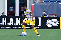 FOXBOROUGH, MA - MAY 16: Waylon Francis #14 Columbus SC prepares to advance the ball during a game between Columbus SC and New England Revolution at Gillette Stadium on May 16, 2021 in Foxborough, Massachusetts.