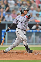 Kannapolis Intimidators catcher Omar Narvaez #10 swings at a pitch during a game against the Asheville Tourists at McCormick Field on June 5, 2014 in Asheville, North Carolina. The Intimidators defeated the Tourists 5-3. (Tony Farlow/Four Seam Images)
