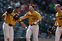 Alex Peterson (14) of the Missouri Tigers celebrates with teammates Austin James (23) and Peter Zimmermann (40) after hitting a home run against the Oklahoma Sooners in game four of the 2020 Shriners Hospitals for Children College Classic at Minute Maid Park on February 29, 2020 in Houston, Texas. The Tigers defeated the Sooners 8-7. (Brian Westerholt/Four Seam Images)