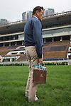 SHA TIN,HONG KONG-APRIL 30: Katsumi Yoshida,the representative of Northern Farm,is checking the turf track at Sha Tin Racecourse on April 30,2016 in Sha Tin,New Territories,Hong Kong (Photo by Kaz Ishida/Eclipse Sportswire/Getty Images)