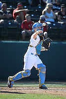 Jake Hirabayashi (28) of the UCLA Bruins throws the ball back to the pitcher during a game against the North Carolina Tar Heels at Jackie Robinson Stadium on February 20, 2016 in Los Angeles, California. UCLA defeated North Carolina, 6-5. (Larry Goren/Four Seam Images)