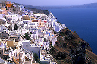 Beautiful Santorini Greece mountains with the magistic white buildings on a cliff.